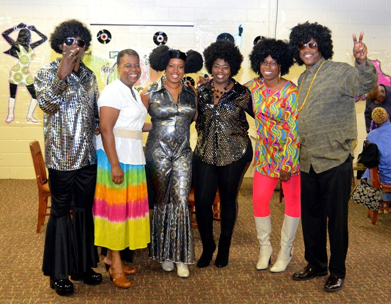 """My family at my 70""""s party last year. Yes that's me with the permed afro puffs."""